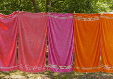 Colourful towels hanging on a rope in the woods Royalty Free Stock Image