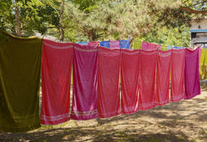 Colourful towels hanging on a rope in the woods Royalty Free Stock Photography