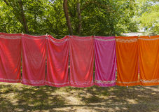 Colourful towels hanging on a rope in the woods Stock Photo