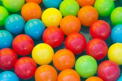Colourful toy balls in a paddling pool royalty free stock images