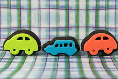 Colourful Toy Car Stamps. Cute colourful toy car stamps  on funky patterned background Stock Photo