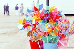 Colourful toy windmills on display at beachside in Southwold, UK royalty free stock photos