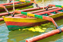 Colourful traditional Balinese fishing boats. In line on the water Royalty Free Stock Image