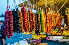 Colourful Traditional Georgian sweet Churchkhela hanging on the market. stock photography
