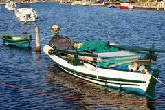 Wooden Fishing Boat, Lefkada Greek Island, Greece. Colourful traditional wooden fishing boat in the lagoon or inner harbour, Lefkada, an Ionian Greek Island, at royalty free stock photography