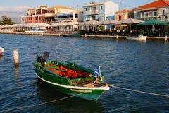 Colourful Fishing Boat, Lefkada Greek Island, Greece. A colourful traditional wooden fishing boat in the lagoon or inner harbour, Lefkada, an Ionian Greek Island royalty free stock photography