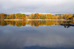 Colourful trees reflecting in lake. Royalty Free Stock Images