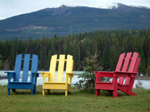 Colourful trio. Relaxing in front of the mountains Royalty Free Stock Image
