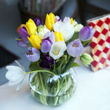 Colourful tulips in glass vase Stock Photography
