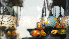 Colourful turkish lamps from glass mosaic glowing. Arabic multi colored authentic retro style lights. Many illuminated