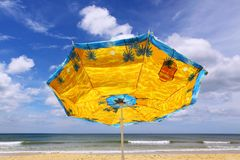 Colourful umbrella and sea. Colourful umbrella sea beach windy Royalty Free Stock Photo