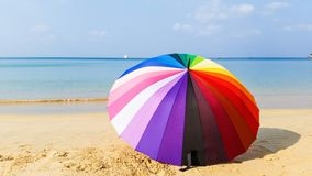 Colourful umbrella on white sand sea and blue sky Royalty Free Stock Images