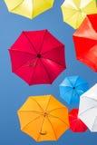 Colourful umbrellas against a blue sky Stock Photos