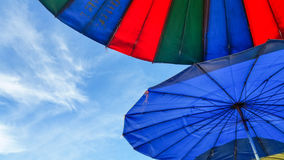 Colourful umbrellas and blue sky background Royalty Free Stock Image