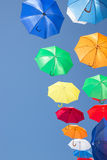 Colourful umbrellas hanging in a blue sky Royalty Free Stock Photography