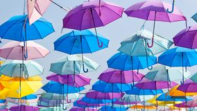 Colourful umbrellas floating in the air, againt the blue sky royalty free stock photo