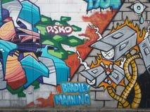 Colourful urban graffiti. Expression or prejudice?. Colourful graffiti featuring Bradley Manning on urban wall in Thailand, urban art of vandalism Royalty Free Stock Photo
