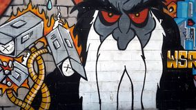 Colourful urban graffiti. Expression or prejudice?. Colourful graffiti featuring Bradley Manning on urban wall in Thailand, urban art of vandalism stock video footage