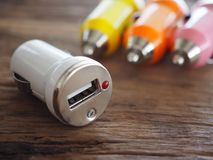 Colourful USB Car Charger on a wooden board with technology and energy concept stock image