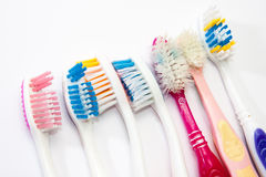 Colourful used toothbrushes Stock Photo