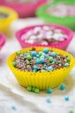 Colourful vertigo muffins different colors Stock Photography