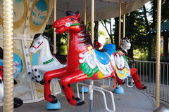 Colourful vintage carousel in a summer park. Stock Images