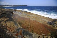 Colourful volcanic coastline Stock Image