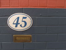 Colourful wall. With house number and letter box Royalty Free Stock Photography