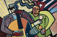 Colourful wall painting in Havana, Cuba. A colourful wall painting in Old Havana, describing their typical music and dance royalty free stock images
