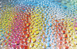 Colourful water drops Stock Image