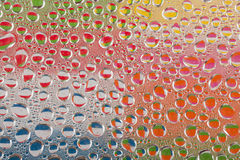 Colourful water drops stock images