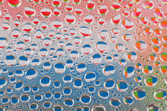 Colourful water drops royalty free stock images