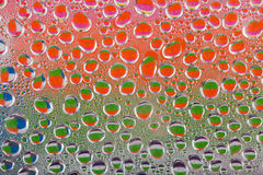 Colourful water drops stock photos