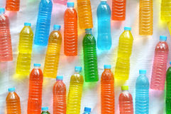 Colourful water in plastic bottle Stock Photography