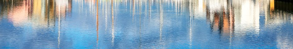 Colourful water reflections - banner image royalty free stock photography