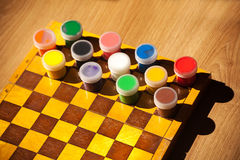 Colourful watercolor paint on the chessboard Royalty Free Stock Image