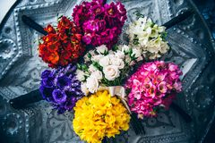 Colourful wedding bouquet arrangement lying on a vintage patterned tray stock photos