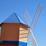 Colourful windmill in bright  blue sky Stock Photos