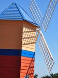 Colourful windmill in bright  blue sky Stock Image