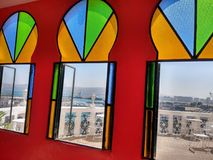 Colourful windows. View from the inside of a colourful Arabic style hotel in Morocco Royalty Free Stock Images