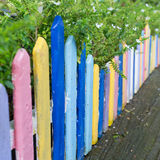 Colourful wood fence in small garden Stock Photo