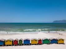 Colourful wooden beach huts at Muizenberg beach stock images