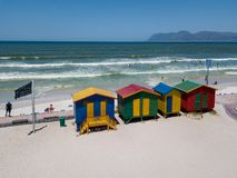 Colourful wooden beach huts at Muizenberg beach stock photos