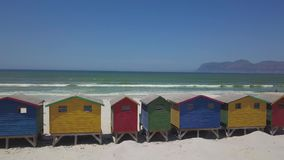Colourful wooden beach huts at Muizenberg beach stock video footage
