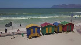 Colourful wooden beach huts at Muizenberg beach stock video