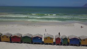 Colourful wooden beach huts at Muizenberg beach stock footage