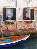 Colourful Wooden Boat in Venice Canal Royalty Free Stock Photography