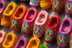 Perspective view of colorful wooden dutch shoes. Row of dutch clog shoes on display Royalty Free Stock Photo