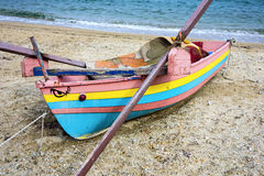 Colourful Wooden Fishing Boat on Beach Stock Photos