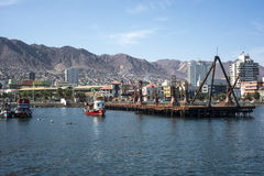 Colourful wooden fishing boats in the harbour at Antofagasta. Antofagasta, Chile - April 5, 2015: Colourful wooden fishing boats in the harbour at Antofagasta in Stock Photography